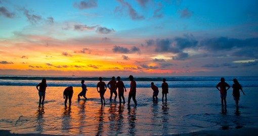 Enjoy fabulous sunsets at Kuta beach while on your Bali vacation.