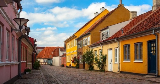You will see the city of Odense during your Denmark trip.
