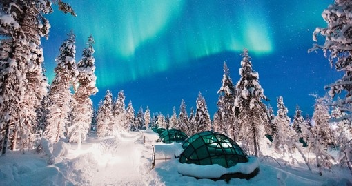 Watch out for the northern lights while visiting Kakslauttanen on your Finland Tour
