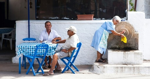 An evening at a traditional Greek Restaurant is sure to be a highlight of any Greece vacation package.