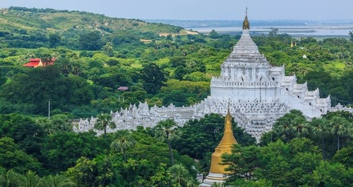 Explore The Hsinbyume White Pagoda during your Myanmar Tours.