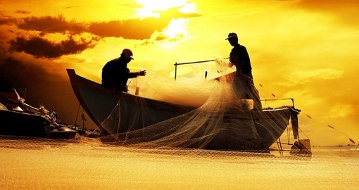 Silhouette of Vietnamese fishermen - a photo opportunity for all Vietnam vacations.
