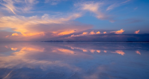 Marvel at an Uyuni sunset on your Bolivia Vacation