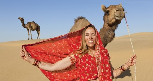 Posing in a saree with camels in Rajasthan