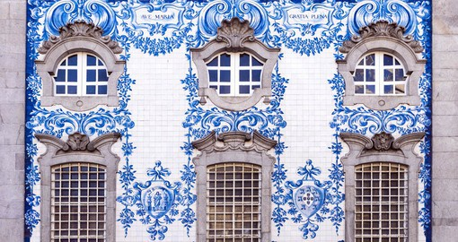 The buildings of Porto's Praca de Ribeira area are covered in glazed tiles