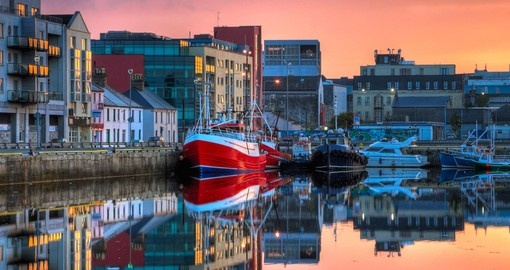 In Galway enjoy beautiful view of the fishing boats in docks during your next trip to Ireland.