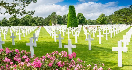 The American Cemetery near Omaha Beach has 9,386 graves marked with perfectly aligned white marble headstones