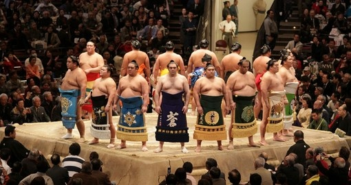 High ranking sumo wrestlers line up at Tokyo Grand Sumo Tournament. Try and include a wrestling event on your Japanese vacation.