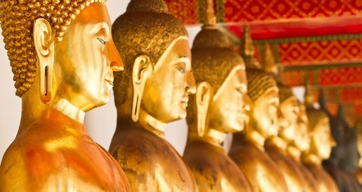 Come face to face with the gold plated Buddha statues that are located in Wat Po on your Thailand Vacation