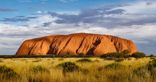 One of the great natural wonders of the world, Uluru/Ayers Rock towers above the surrounding landscape
