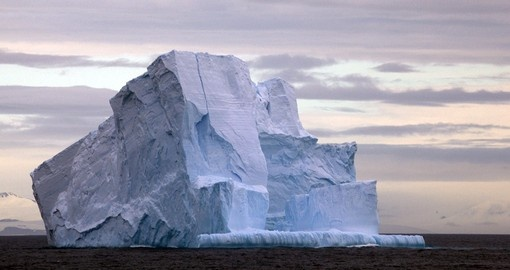 Cross the Drake Passage where giant floating icebergs are prevalent in the region during your Antarctica Cruise