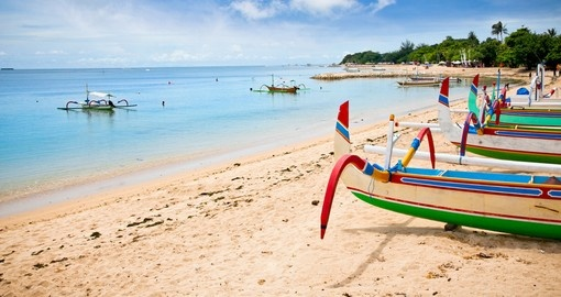 Walk along the beach in Bali where you have the opportunity to rent a traditional fishing boat to explore the ocean on your Bali Vacation