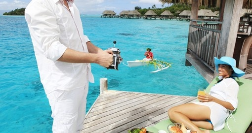 Have breakfast delivered to your overwater bungalow included in your Bora Bora Vacation Packages.