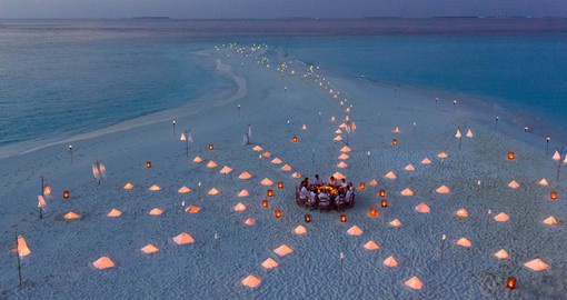 Enjoy dinner on the Maldives' signature white-sand beaches