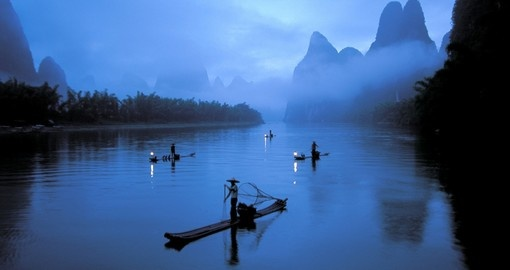 Fishermen on the misty Li River at dusk - Guilin