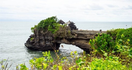 On your Bali Tour, visit the Uluwatu Temple that is situated on a rocky outpost that extends into the ocean