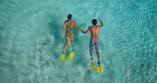 Couple snorkeling on honeymoon
