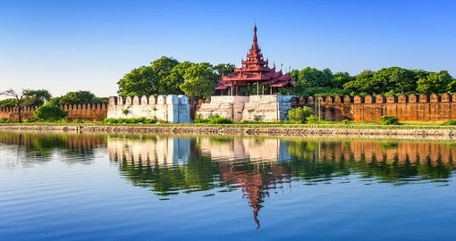The palace wall and moat of Mandalay is just one of the stops on your Myanmar Vacation.