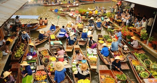 Glide along the waterways and experience what Bangkoks floating market has to offer on your Trip to Thailand