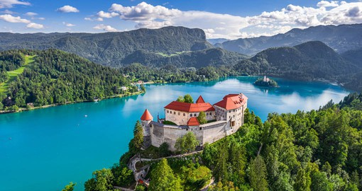 The most beautiful view of Bled, its island, and surrounding peaks is from the castle towering over the lake