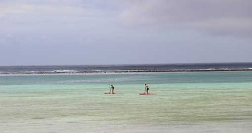 Enjoy Paddle Boarding on the open ocean during your next Cook Island tours.