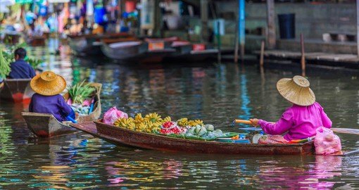 Visit Bangkok's legendary floating markets