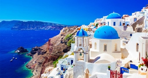Wander about Oia Town on Santorini Island and enjoy the beautiful architecture of the hillside town on your Greece Vacations