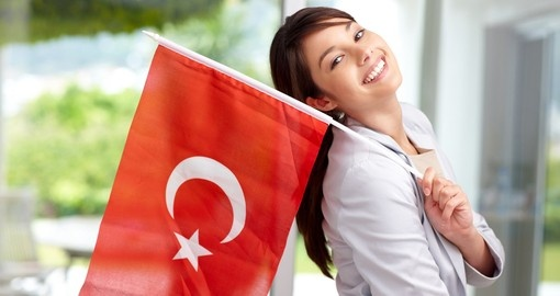 Portrait of a young woman holding a Turkish flag